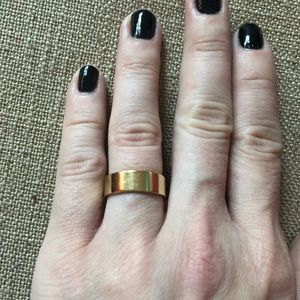 Gold colored ring (band) size 7